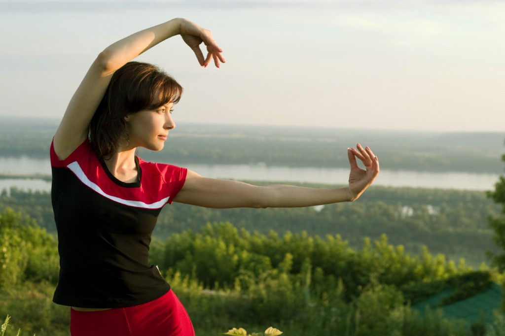 young beautiful girl doing some exercises in the meadow