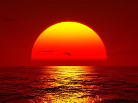 sunset-big-orange-sun-setting-over-ocean